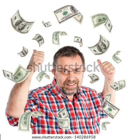 Happy businessman and a rain of 100 dollar bills