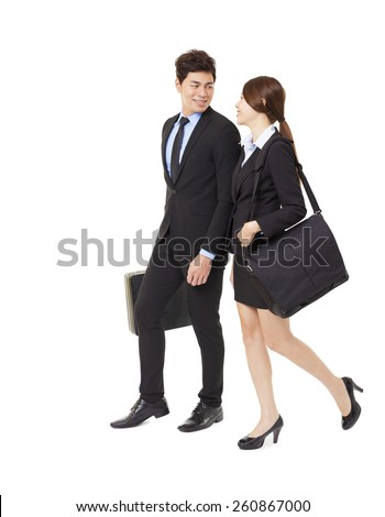 happy businessman and businesswoman walking together isolated on white - stock photo