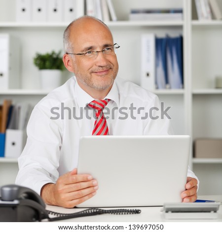happy businessman at work with laptop - stock photo