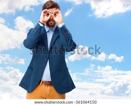 happy businessman binoculars sign - stock photo