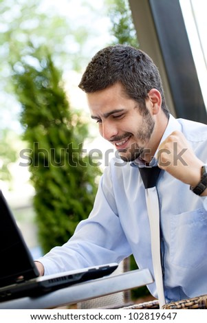 Happy businessman browsing  on internet, he looking in laptop