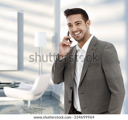 Happy businessman calling with mobile phone. - stock photo