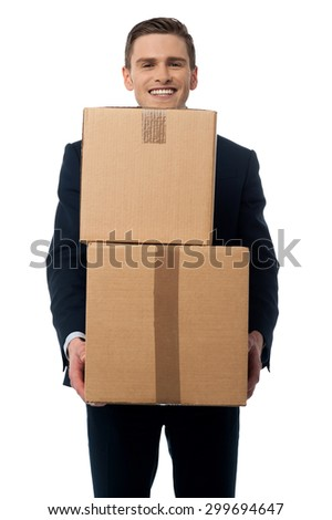 Happy businessman carrying cardboard boxes.