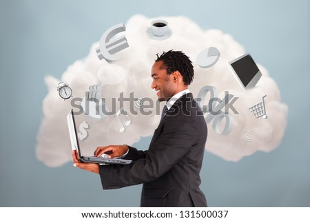 Happy businessman connecting to cloud computing with laptop