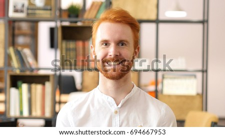 Happy businessman, Designer,  Red Hair Beard Man in Office