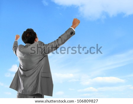 Happy businessman expressing success and victory concept