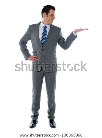 Happy businessman giving presentation on white background - stock photo
