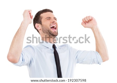 Happy businessman. Happy young man in shirt and tie expressing positivity and gesturing while standing isolated on white