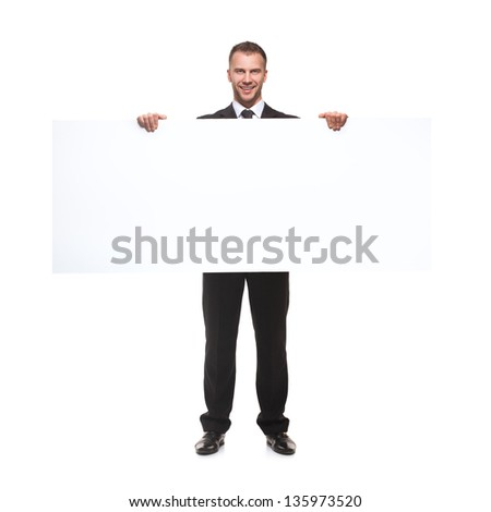 Happy businessman holding blank billboard isolated on white background