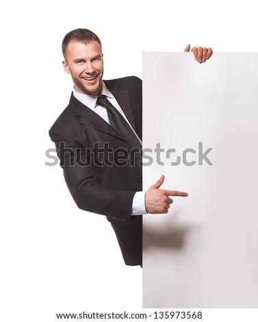 Happy businessman holding blank billboard isolated on white background - stock photo