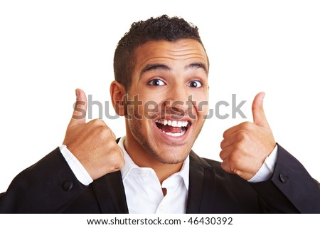 Happy businessman holding his two thumbs up
