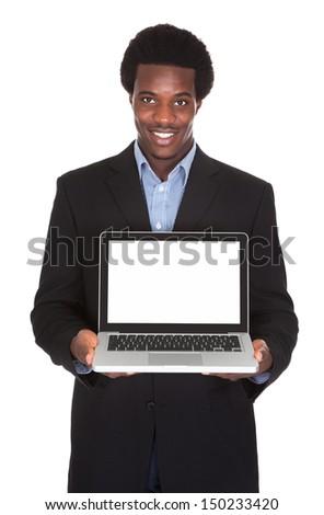 Happy Businessman Holding Laptop Isolated On White Background - stock photo