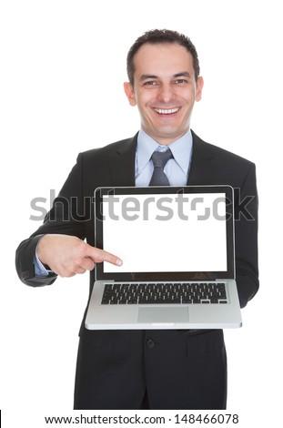 Happy Businessman Holding Laptop Over White Background - stock photo