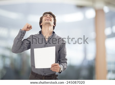 Happy businessman holding the paper - stock photo