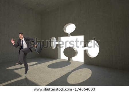 Happy businessman in a hury against jigsaw shaped door in dark room