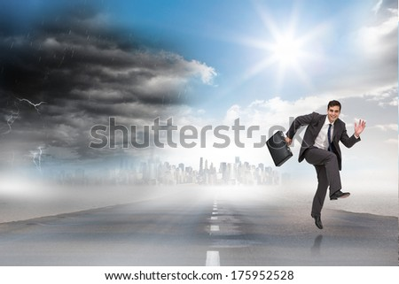 Happy businessman in a hury against open road