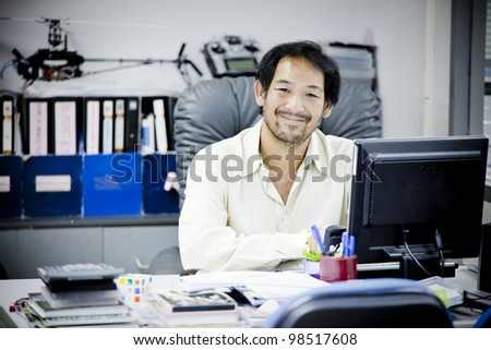 happy businessman in front of the computer.
