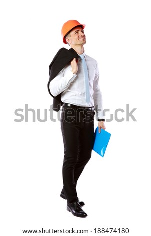 Happy businessman in helmet with blue folder over white background - stock photo
