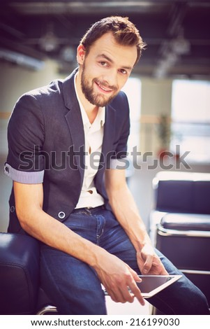 Happy businessman in smart casual looking at camera with smile - stock photo