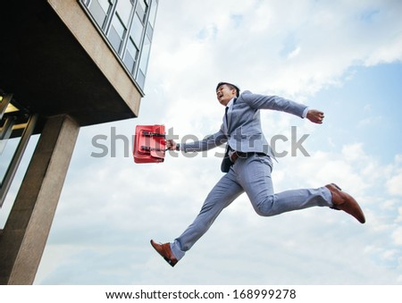 happy businessman jumping for success - stock photo