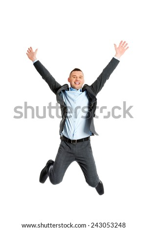 Happy businessman jumping in the air - stock photo