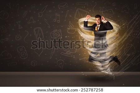 Happy businessman jumping in tornado concept on brown background - stock photo