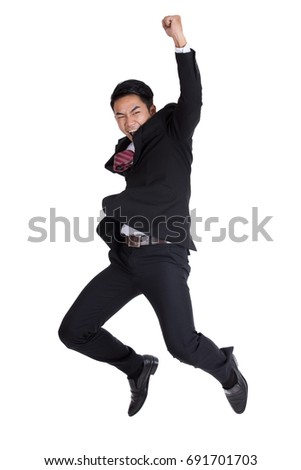 Happy businessman jumping isolated over a white background.