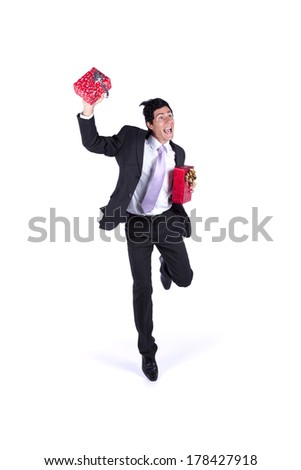 happy businessman jumping with some gift present isolated on white (some motion blur) - stock photo
