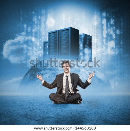 Happy businessman meditating in front of earth with servers - stock photo