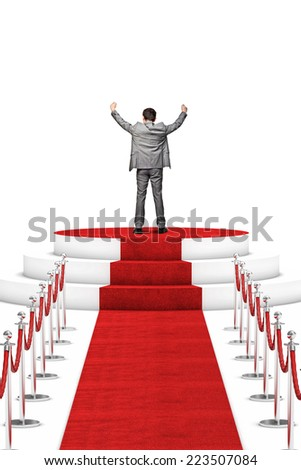 happy businessman on red carpet