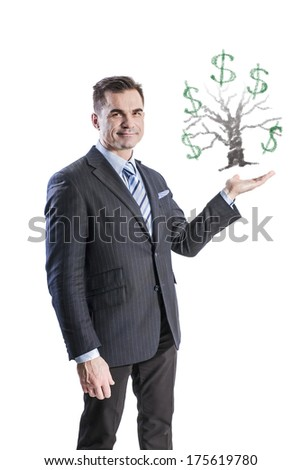 Happy businessman picked up a top hand of the money tree