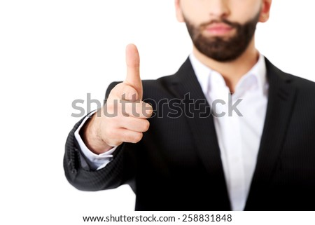 Happy businessman pointing his finger on you. - stock photo