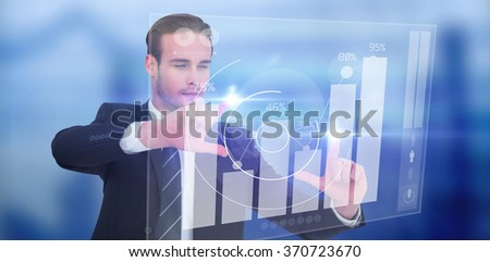 Happy businessman pointing with fingers against percentages graphical representation - stock photo