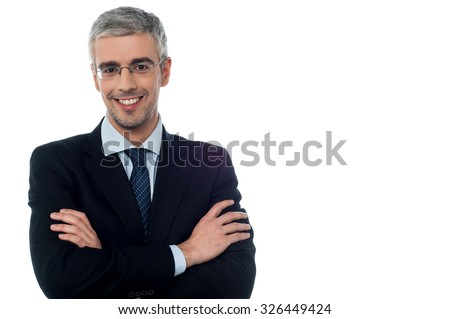 Happy businessman posing with arms folded