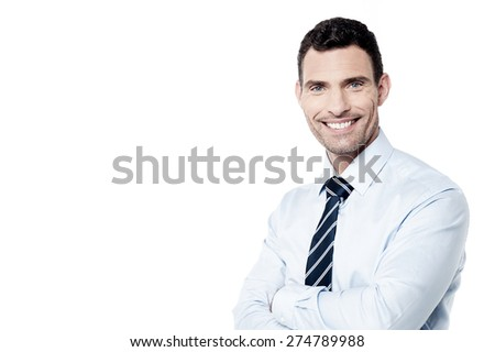 Happy businessman posing with crossed arms