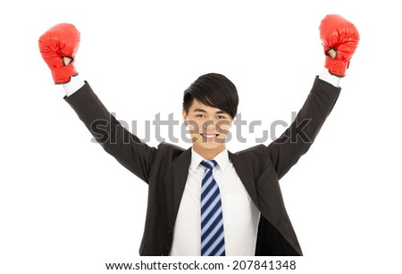 happy businessman raises hands with gloves  - stock photo