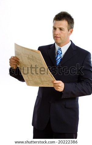 Happy businessman reading financial newspaper, smiling, isolated on white.