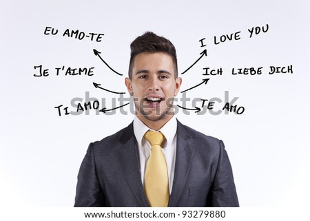 Happy businessman saying I Love You in portuguese, french, english, italian, spanish and german - stock photo