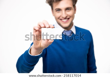 Happy businessman showing blank business card. Focus on card - stock photo