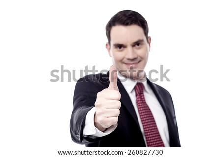 Happy businessman showing thumbs up gesture - stock photo