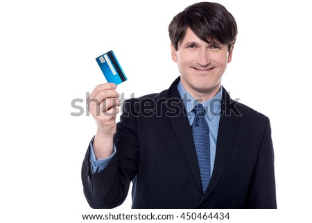 Happy businessman showing up his credit card.