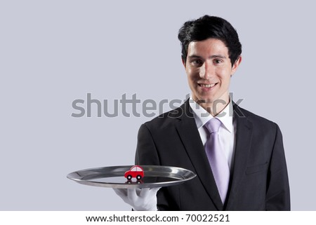 happy businessman showing you car services solutions - stock photo
