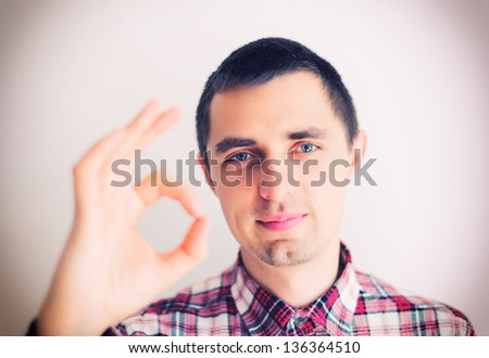 happy businessman shows OK - stock photo