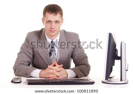 happy businessman sitting at a laptop on a isolate