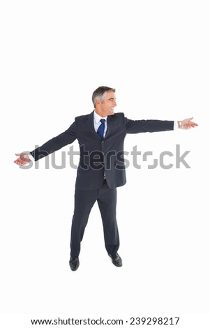 Happy businessman spreading his arms on white background