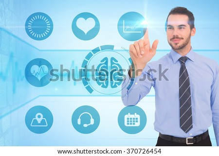 Happy businessman standing and pointing up against medical background with blue ecg line - stock photo