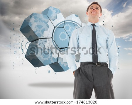 Happy businessman standing with hands in pockets against blue key in sky - stock photo