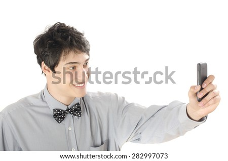 Happy businessman taking a selfie photo with his smart phone. Elegant man holding mobile phone. Isolated on white background.