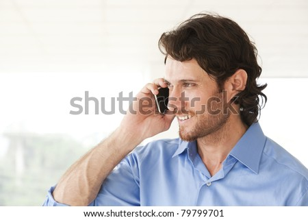 happy businessman talking over the cell phone