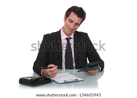 Happy businessman with a calculator